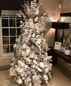 Jingle bell rock!Coleen Rooney, 30, shared a proud snap of her impossibly lavish Christmas tree on Instagram on Tuesday morning, simply captioning the festive shot: 'Good morning'