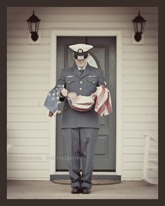 I adore this picture! What a great idea to have your service Member outside your house holding the new baby in a flag