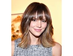 @Byrdie Beauty - Run a smoothing product, like Living Proof's Perfect Hair Day 5-in-1 Styling Treatment ($26), through your hair before blow-drying with a paddle brush to achieve Katherine McPhee's polished style.
