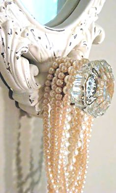 I would love a cute little door knob with a mirror so I can hang my pearls in the bathroom. The water mist is good for them!
