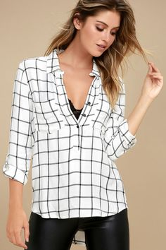 $42   You're guaranteed to have a good day when you've got on the Good to Me White Grid Print Long Sleeve Top! Soft, woven fabric, with a black and white grid print, falls from a collared neckline, into a relaxed bodice with partial button placket, two patch pockets, and a rounded, high-low hem. Long sleeves can be rolled up thanks to handy button tabs.
