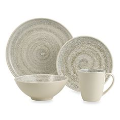 Sango Soho Dinnerware features a deep coup shape with a large eating surface area decorated with sponge-like print and a handcrafted spin that results in a hand-thrown look from a potter's wheel.