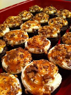 Salted Caramel Cupcakes: Unwrap the Heath (or Skor) bars, keep them in their packaging and start smashing.  Pour the crushed up heath bars into a bowl.  Then, after the cupcakes are cooled, frost them with the buttercream, roll them into the heath bars, then drizzle with more salted caramel.  DeVore used a decorative tip to pipe the icing on top, just makes it look a little more fancy.