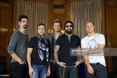 Kevin Richardson, Howie Dorough, Nick Carter, A.J. Maclean and Brien Littrell of Backstreet Boys present their new album 'In A World Like This' at the Palace Hotel on November 12, 2013 in Madrid, Spain.