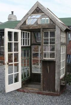 Greenhouse with recycled windows and door. purchase old windows, doors and at least one stained glass from vintage shops. Window Greenhouse, Greenhouse Shed, Small Greenhouse, Greenhouse Gardening, Greenhouse Wedding, Gardening Shoes, Recycled Windows, Old Windows, Reclaimed Windows