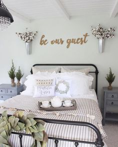 Farmhouse guest bedroom with rod iron bed from bedding from black crystal chandelier from and be our guest wood signs. Decor, Farmhouse Guest Bedroom, Home Bedroom, Bedroom Makeover, Rustic House, Bedroom Design, Guest Bedrooms, Bedroom Decor, Home Decor