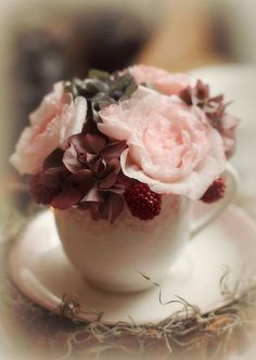 This is a perfect use for antique, maybe a little less than perfect, tea cups - so pretty.