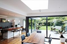 kitchen dining glass extension home.. I love the outdoor (not outdoorsey) feel to this house.