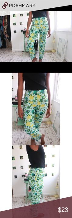 Floral Trousers Bio: This floral bottom features yellow, green and blue floral print. Details: Side zip closure Waist: 28 inches Hips: 38 inches Rise: 10 inches Inseam: 27.5 inches Full Garment Length: 37.5 inches Estimated size: 4/5 Marked size: 4 Label:Ann Taylor Color: Blue Fabric:100% Silk Lining/100% Acetate Shell Condition/Care:Excellent/ Dry Clean Model Stats: Height: 5'5 Pants Trousers