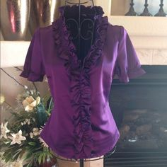 The Limited Purple Ruffled Top The Limited purple ruffled top, zipper on left side, shiny and stretchy. 96% polyester 4% spandex New York & Company Tops