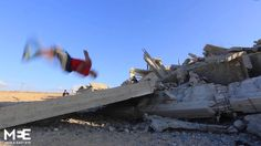 Palestinians perform Parkour over the ruins of Gaza
