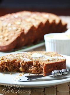 Banana Bread with Coconut and Almonds. Super MOIST and easy! via @Sommer | A Spicy Perspective #baking #bread #banana