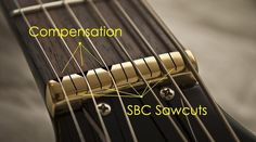 "Compensated/SBC Concept Brass Nut (Gibson style) by GuitarTechs - The SBC Concept is based on the theory ""at each individual string would play louder and have a more pure tone if each string had a separate nut... [The] narrow slots between each string slot [insulate] the slots from each other. The acoustic energy produced by each string is automatically concentrated below that string slot. It does not migrate across the nut length. Purer tone, increased volume."""