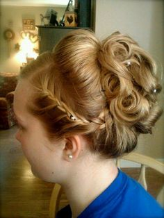 Like the chignon in the back, but not the braid.