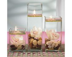 Floating Water Candle For Wedding Table CentrePieces  ---  everything except the flowers (unless you get fake ones) can be purchased at the Dollar Tree