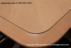 Maryland Executive Conference Table in Light Maple. The edges are made with solid wood.