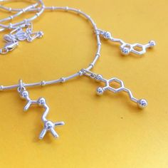 creativity necklace in sterling silver - serotonin, dopamine, acetylcholine molecules