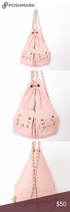 "Blush Pink Faux Leather Spiked Backpack ASOS — Street Level  ⌁ Measurements: 14.5"" height 11"" width 6"" depth 34"" strap length (each)  ⌁ Material: 100% polyurethane  ⌁ Condition: Used a handful of times. Chain strap has some tarnishing and there are faint stains on the bottom. Flaws are not noticeable.  Comment below if you have any questions. Please make all offers using the ""offer"" button. No trades. No holds. Comes from a smoke-free/pet-free home. Not responsible for lost/damaged mail. All…"