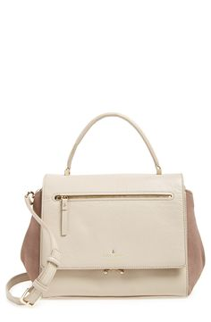 This pebbled leather satchel from Kate Spade perfectly balances contemporary and classic styles with a modern flap design and an elegant top handle.