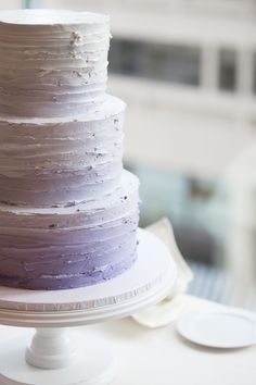 Purple ombre wedding cake, I like this but want pink. :)