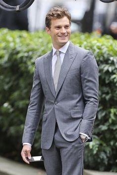 Entertainment Tonight - News - Jamie Dornan Bulges Out During 'Fifty Shades of Grey' Reshoots (Oct 13 Fifty Shades Cast, Fifty Shades Trilogy, Fifty Shades Of Grey, Cristian Grey, Mr Grey, Gray, Tailored Suits, Suit Fashion, Tight Leggings