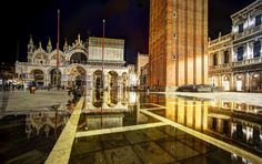 Some nights the water comes up so high that the St. Mark's square starts to flood. While unfortunate, it's actually mega awesome for photography! Rene and I would swing by this square every single night to see if there was a flood… - VENICE, ITALY - photo from #treyratcliff Trey Ratcliff at http://www.StuckInCustoms.com