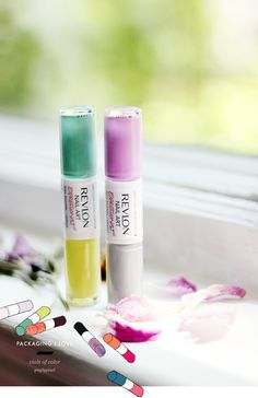 Revlon Nail Art packaging - Each of these little bottles has one top that serves two containers of nail polish. On one end is the base color and the other is an accent color for nail art.
