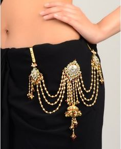 """. Ethnic waist charm (kandora) Not only this adds to the charm of an ethnic attire, but if it is heavy enough (<100gms) & the hook is 3"""" long & 1"""" wide (approx) & it is inserted about 1.5 to 2"""" apart from the center line of the body, the hook activates acupressure points related to the throat, and acts to keep it clear of phlegm, so that the voice remains clear, & becomes easier to clear if required. It's a boon for women who need to clear their throat frequently."""