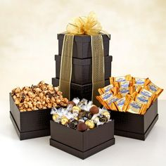 ffc72c7e28216 Gourmet Gift Towers offer a delicious assortment of chocolates and other  sweets inside a tower of artfully designed gift boxes and tied together  with a ...
