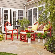 I love the bright red furniture + accents on this patio