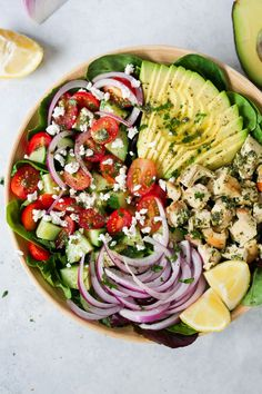 This healthy, filling and delicious Pesto Chicken Salad Recipe is loaded with lettuces, cherry tomatoes, avocado, red onions and a light lemon dressing.