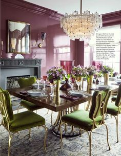 A gray Oushak designer rug in the dining room of a Manhattan house ...mauve lacquered walls...designed by Celerie Kemble - House Beautiful Magazine September 2016