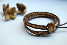 Leather-bracelet with glassbeads, available on DaWanda.