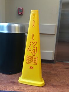 I am dieting so to the world this is a Wet Floor cone but to me it is a man excitedly jumping over a pile of bacon.