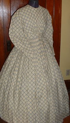 Just add collar and cuffs.  From The Graceful Lady -- don't love this one -- the checks are too large for my personal taste and the color is drab. Good reminder when shopping for fabrics.
