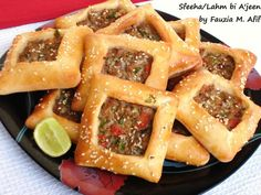 Sfeeha are a kind of middle eastern meat pies. In some parts they are known as lahm bi ajeen (which translates to 'meat with dough'). Their unique shape makes them look like little windows of goodness!