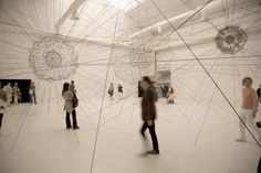 galaxies forming along filaments, like droplets along the strands of a spider's web. by tomas saraceno