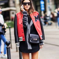 Red leather varsity jacket paired with a LBD