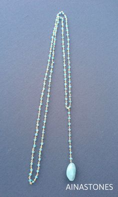 Necklace made with apatite rosary chain and aquamarine pendant
