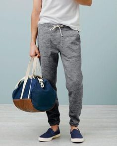 Comfy grey tracksuits. Casual wear for men. Love the nautical style duffle bag too.