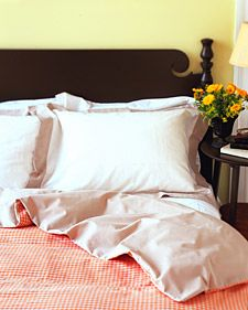 """DIY Homemade Duvet Cover. """"Make a comforter cover out of two flat sheets. Place sheets right sides facing each other; sew around perimeter with a 1/2-inch seam allowance, leaving one short end open; turn inside out. To fasten cover, use twill-tape ties, buttons and buttonholes, or Velcro brand tape along the inside edges of the opening"""" // marthastewart"""