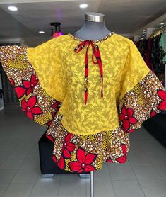 Bouses comes either as peplum, off shoulder, longs sleeve, mid sleeve or sleeveless. A blouse can be described as the icing on the cake of any skirt. Ankara blouses can be woren with either a… African Lace Styles, African Dresses For Kids, African Wear Dresses, Latest African Fashion Dresses, African Print Fashion, African Attire, Boutique, Blouse Styles, African Blouses