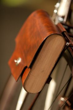 For cyclists who travel light, carry your essentials in a classy leather and cedar pannier
