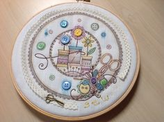 Colouring and embroidery using a Pink Ink design