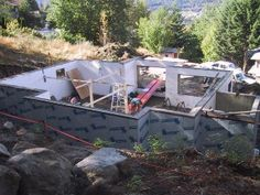 The House Building Blog. This post shows the building of the insulated concrete forms (icf). Once filled with concrete, these forms are left in place and together with the concrete they result in very well insulated walls. For our home we have used a product called Logix blocks.