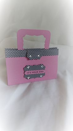 """A beautiful handmade handbag shaped gift bag. Made from quality card stock and designer series paper.    You can easily fit in two bottles of nail varnish, small hand cream,miniature perfume etc (shown in pictures but not included in sale)    (Folds flat for posting)    Measures 5"""" wide 3.25"""" height (not including handle) and approx 1.5"""" depth 