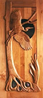 Google Image Result for http://customwoodcarvingart.com/wp-content/gallery/architectural-carving/heron-hand-carved-door.png