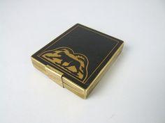 Compact and cigarette case