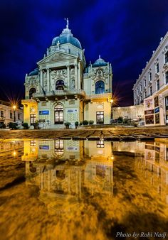 Theatre Square (Színház tér), in the town of Pécs, Hungary, after the rain