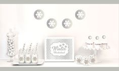 """Silver & Glitter Winter Wonderland Decor Kit. Celebrate your Winter Wedding with a little glitz and glam with our Silver & Glitter Winter Wonderland Decor Kit. Each Kit includes Metallic Foil and Glittery Silver items such as banners, stickers and cupcake toppers for dressing up your dessert and candy buffet table. Kit Includes: 1 Metallic Foil Scallop Banner with White Snowflakes 1 Metallic Silver Table Sign printed with """"Winter Wonderland""""  25 Striped Straws  24 Cupcake..."""